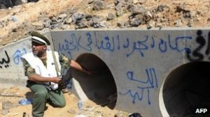 the site where Ghaddafi died, with memorial graffito